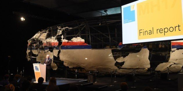 Dutch Safety Board Chairman Tjibbe Joustra speaks in front of the wrecked cockpit of the Malaysia Airlines...