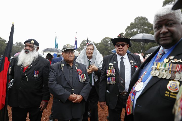 Ex-serviceman from the NSW Aboriginal and Torres Strait Islander Association get ready to march down Anzac Parade.