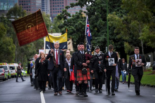 Representatives of WWI battalion associations march near the Shrine of Remembrance on the ANZAC