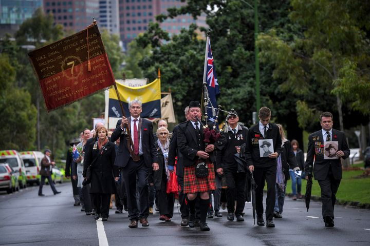 Representatives of WWI battalion associations march near the Shrine of Remembrance on the ANZAC day.