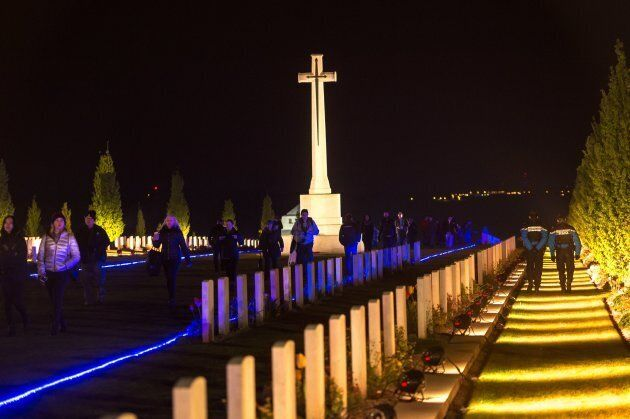 People visit the military cemetery of the Australian National Memorial in Villers-Bretonneux, northern