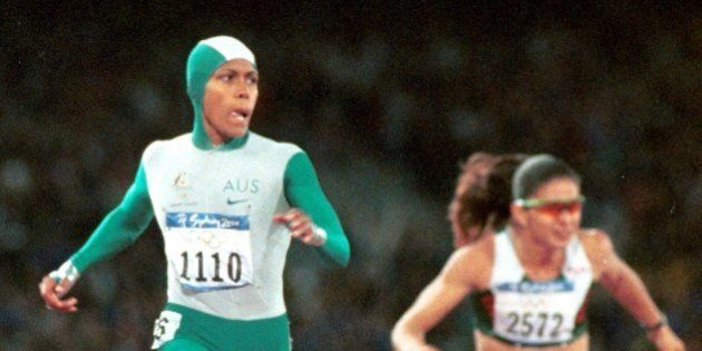 Australia's Cathy Freeman crosses the finish line to win the gold medal in the 400-meter race Monday,...