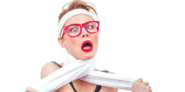 Funny fitness woman playing with her towel, humorous girl, isolated on white