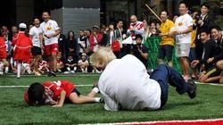 London Mayor Boris Johnson Bodyslams Boy During Rugby
