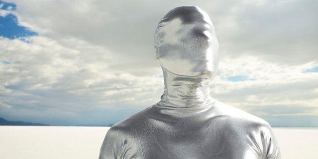 Man in Silver Suit on Salt Flats.