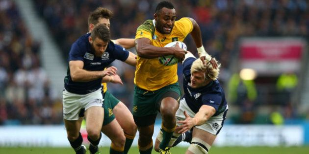LONDON, ENGLAND - OCTOBER 18:  Tevita Kuridrani of Australia breaks past Richie Gray (R) of Scotland during the 2015 Rugby World Cup Quarter Final match between Australia and Scotland at Twickenham Stadium on October 18, 2015 in London, United Kingdom.  (Photo by Dan Mullan/Getty Images)