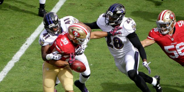 San Francisco 49ers' Jarryd Hayne (38) fumbles a punt-return while tackled by Baltimore Ravens' Anthony...
