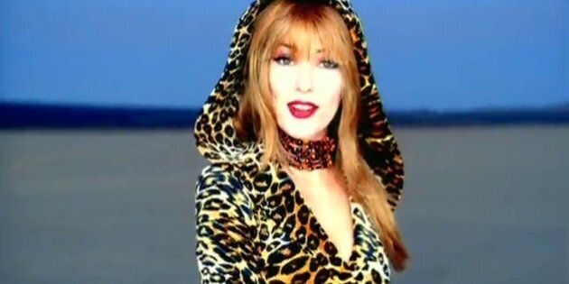 Shania Twain in her iconic hooded leopard skin outfit from the music video