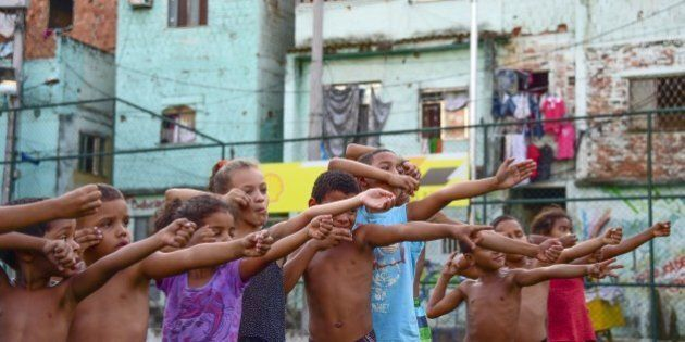 Children from the Sao Carlos Shantytown learn archery in Rio de Janeiro, Brazil on September 16, 2015....