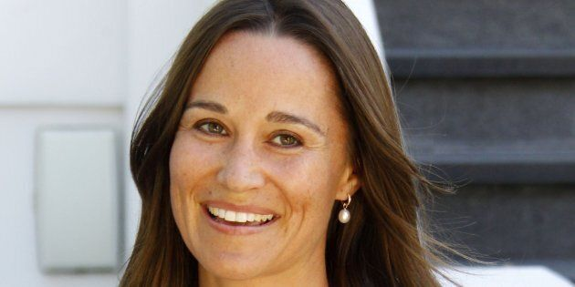 Picture Shows: Pippa MiddletonJuly 19, 2016Pippa Middleton is all smiles as she steps out in London after announcing her engagement to James Matthews.The sister of Kate Middleton, the Duchess of Cambridge, was dressed in a knee-length white dress and flat brown sandals and a matching brown purse.Non ExclusiveWORLDWIDE RIGHTSPictures by : FameFlynet UK � 2016Tel : +44 (0)20 3551 5049Email : info@fameflynet.uk.com