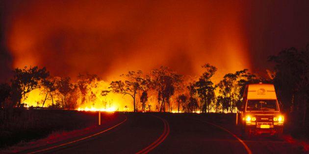 Bush fire at Arnhem Highway at night, Kakadu National Park, Northern Territory, Australia