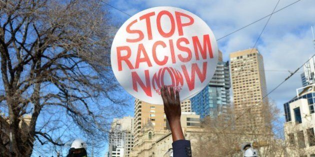 MELBOURNE, AUSTRALIA - JULY 18: An anti-racism activist holds up a placard as anti-Islam protesters stage...