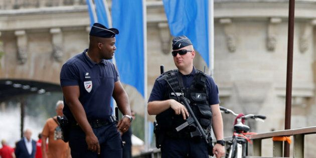 Policemen patrol during the opening day of the Paris Plages beach festival along the banks of River Seine in Paris, France, six days after a truck driver killed 84 people when he mowed through a crowd on the French Riviera, July 20, 2016. REUTERS/Charles Platiau