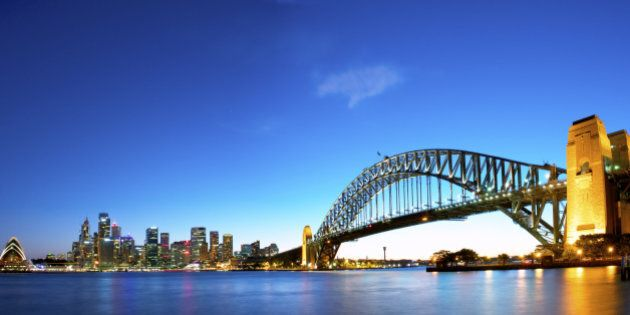 Panorama of Sydney Harbour with the opera house to the left, Financial district in the middle, and the...