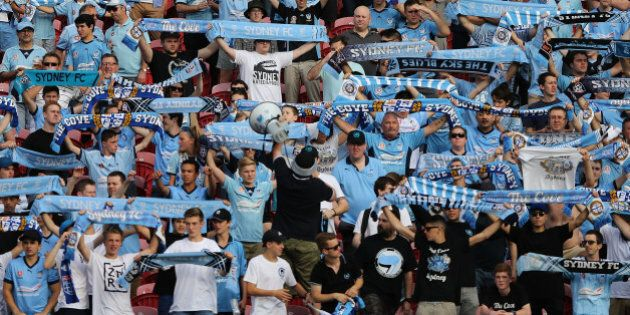 NEWCASTLE, AUSTRALIA - OCTOBER 17:  Sydney FC fans show their support during the round two A-League match between the Newcastle Jets and Sydney FC at Hunter Stadium on October 17, 2015 in Newcastle, Australia.  (Photo by Ashley Feder/Getty Images)