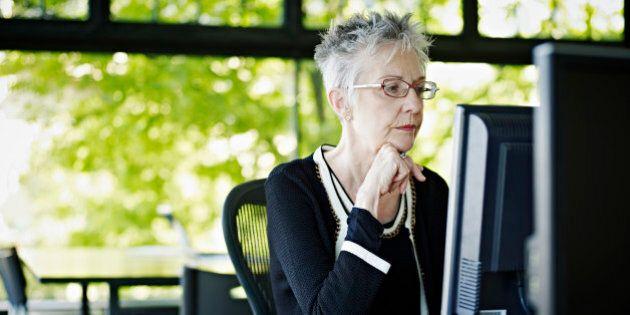 Businesswoman working on computer in