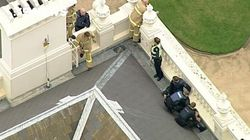 Shirtless Man Arrested On Roof Of Government House In