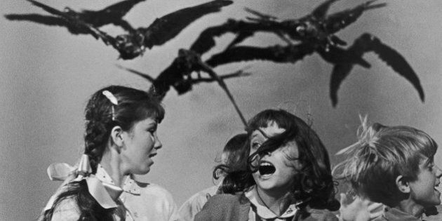 A group of schoolchildren flail about in terror at the avian attack in a publicity still for 'The Birds',...