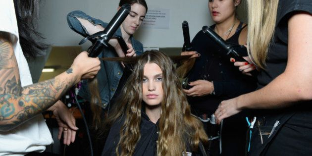 MILAN, ITALY - SEPTEMBER 27: A model is seen backstage ahead of the Trussardi show during Milan Fashion...