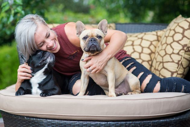 Caroline at home with her French bulldogs, Diesel and Brie. Who knew French bulldogs were so