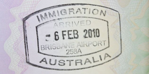 A close up of a passport stamp for immigration to