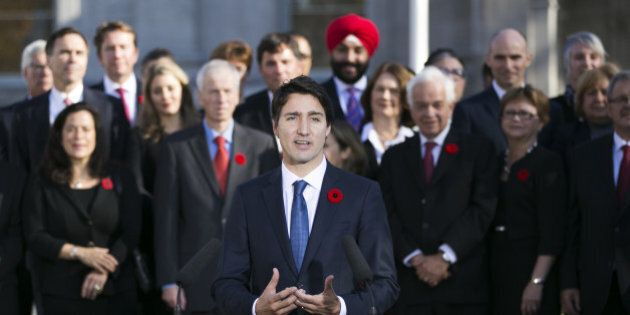 OTTAWA, Nov. 4, 2015-- Newly elected Canadian Prime Minister Justin Trudeau, front, delivers a statement...