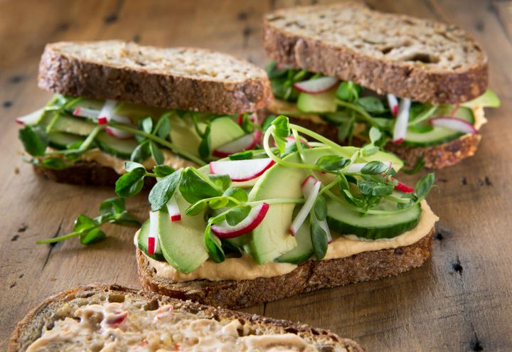 Use hummus as your sandwich spread and squeeze in as many salad veggies as possible.