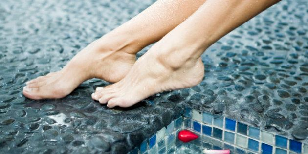 Woman's legs at the poolside