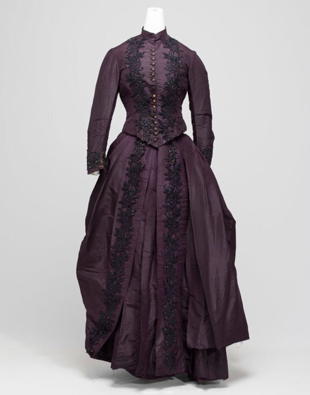 The provenance of this purple dress is unknown, but is an example of how women wore their best dress for the marriage thereby saving on cost.