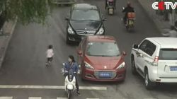 Chinese Toddler Survives After Being Run Over...