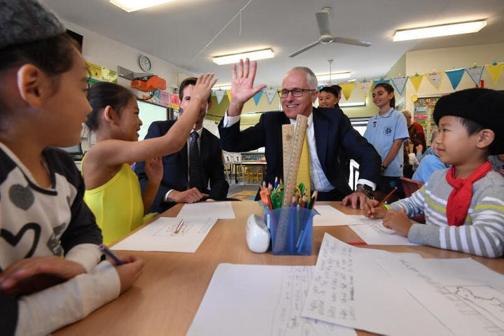 Prime Minister Malcolm Turnbull risks high-fiving kids at North Strathfield Public School.