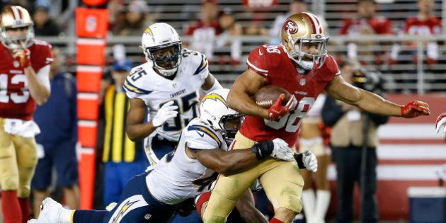 San Francisco 49ers running back Jarryd Hayne (38) runs past San Diego Chargers linebacker Chi Chi Ariguzo,...