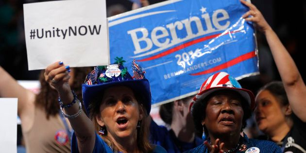 A protester, and supporter of Senator Bernie Sanders march in opposition to Hillary Clinton ahead of the Democratic National Convention in Philadelphia, Pennsylvania, U.S., July 24, 2016. REUTERS/Bryan Woolston