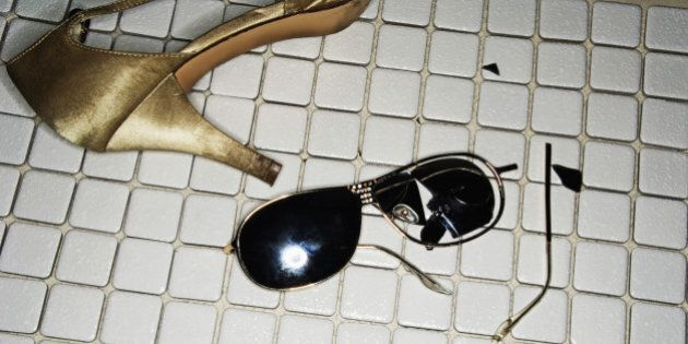 Broken sunglasses and high heel