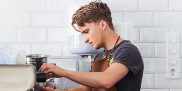 Barista making coffee using espresso machine at