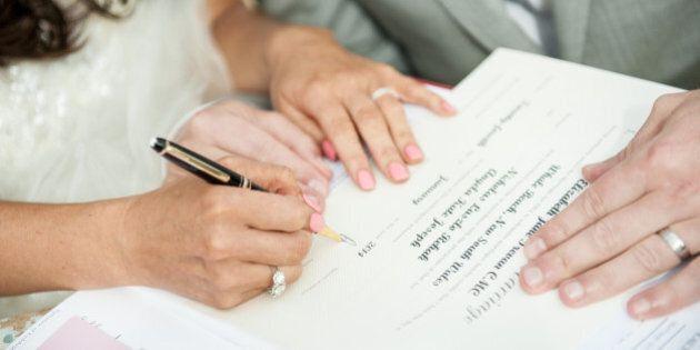 Bride & Groom signing marriage
