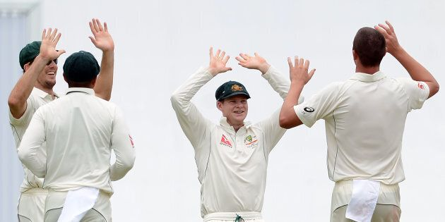 The Aussies players make the hand signal for the number of players they dismissed before