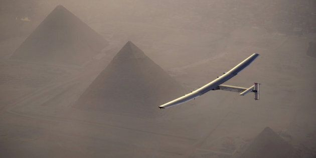 Solar Impulse 2, the solar powered plane, piloted by Swiss pioneer Andre Borschberg is seen during the flyover of the pyramids of Giza on July 13, 2016 prior to the landing in Cairo, Egypt in this photo released on July 13, 2016. Jean Revillard/SI2/Handout via Reuters/File Photo    ATTENTION EDITORS - THIS IMAGE WAS PROVIDED BY A THIRD PARTY. FOR EDITORIAL USE ONLY.