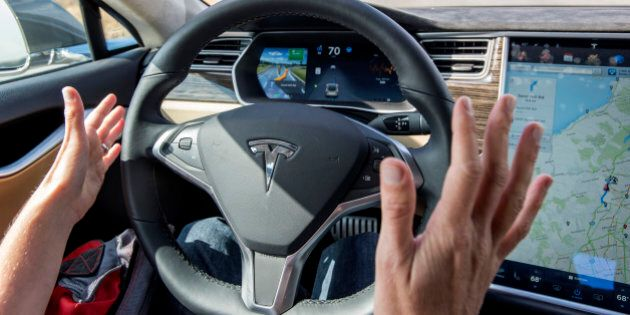 A member of the media test drives a Tesla Motors Inc. Model S car equipped with Autopilot in Palo Alto,...