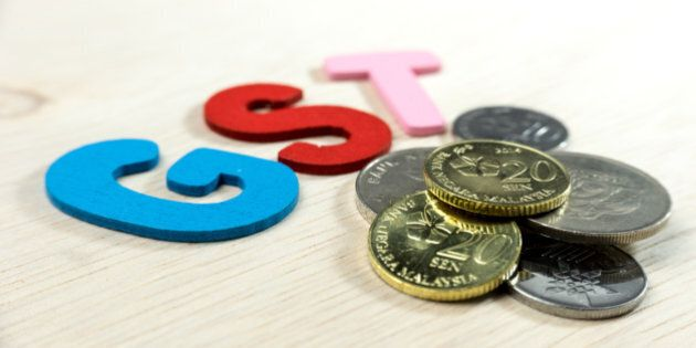 GST or Goods and Services Tax alphabet letters with Malaysian currency. Concept of Government Service...