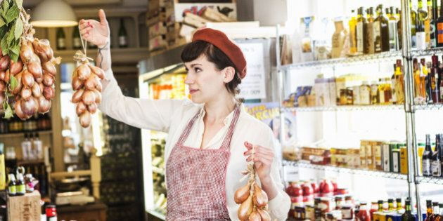 Shopkeeper hanging unions in local farm