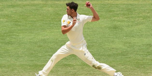 BRISBANE, AUSTRALIA - NOVEMBER 09: Mitchell Starc of Australia fields off his own bowling during day...