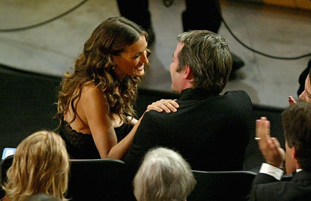 Sarah Jessica Parker hugs her husband Matthew Broderick after winning the award for most annoying female lead to Australian bloggers at the Emmys.