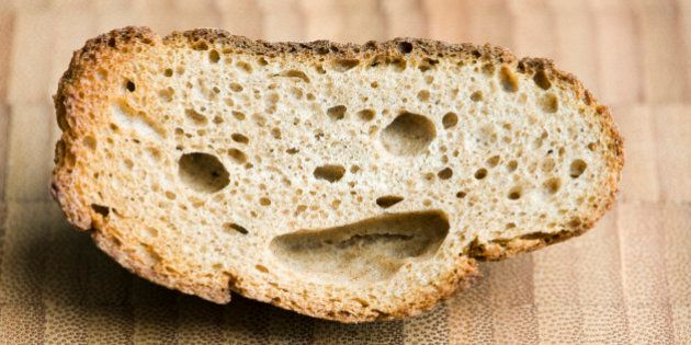 Piece of whole wheat bread with smiley