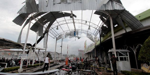 The blast site where the car bomb exploded outside a supermarket in Pattani,
