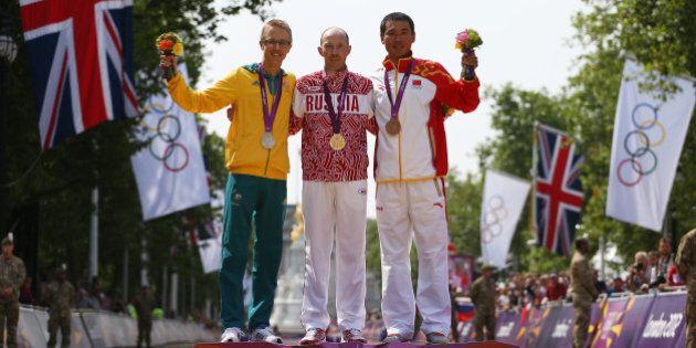 LONDON, ENGLAND - AUGUST 11: (L-R) Silver medalist Jared Tallent of Australia, gold medalist Sergey Kirdyapkin...