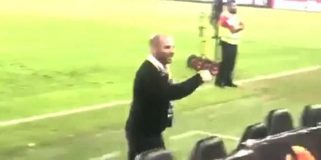 Footage shows George Calombaris shouting and gesturing to members of the crowd in the stadium.