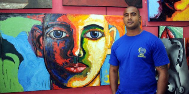 Australian drug smuggler Myuran Sukumaran, one of the so-called 'Bali Nine' gang, stands in front of...