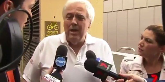 Clive Palmer fronted TV crews outside court on Wednesday, labelling the inquiry into Queensland Nickel a