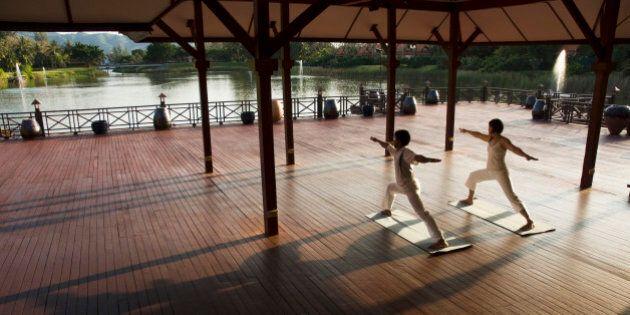 People performing yoga,